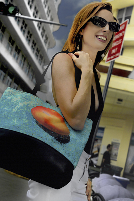 Model, Diane Mooney poses on Lincoln Road with Cortese Designs Mango Blue Casual Totebag
